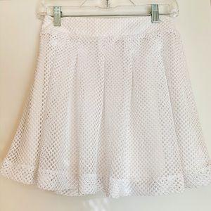 A cute white eye let mini skirt